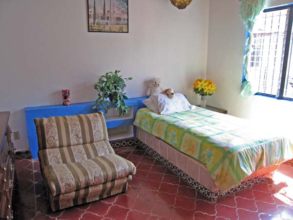 A brightly lit smaller room for an Alzheimers patient.