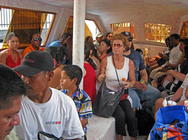 Our water taxi is pretty much chockers - We be jammin' Mon. Belize