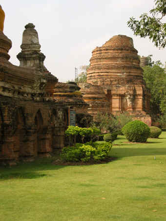 Beautiful green grounds with remains of Stupa, Ayutthaya, Thailand