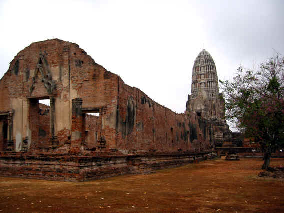 Roofless ruin with Buddha Stupa behind it