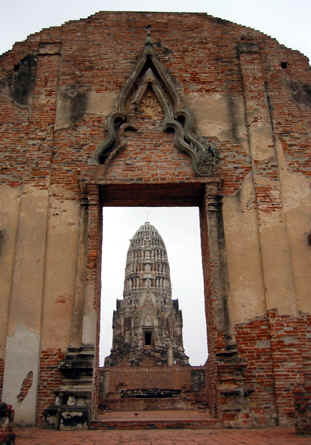 Gateway with a view of large Stupa in the background, Ayutthaya, Thailand