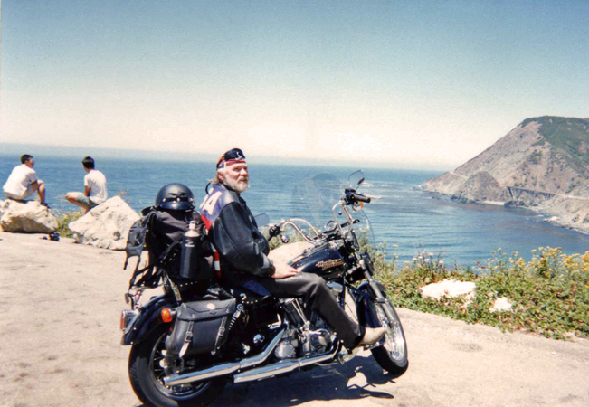Bernie with his bike on one of his many motorcycle trips