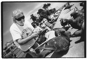 Betty feeding the pigeons at Capitola Beach, California