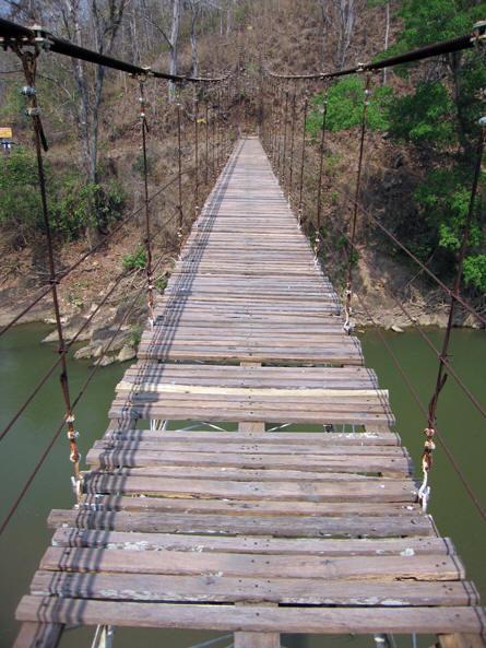 Halfway point of the bridge and the driver is no where to be seen! Hilltribe village, Thailand