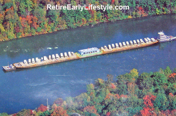 This long, slender barge was his smallest! Mississippi River