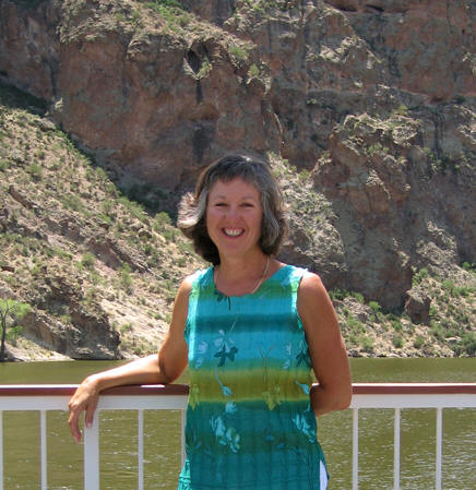 Akaisha leaning on steamboat railing, Canyon Lake, AZ