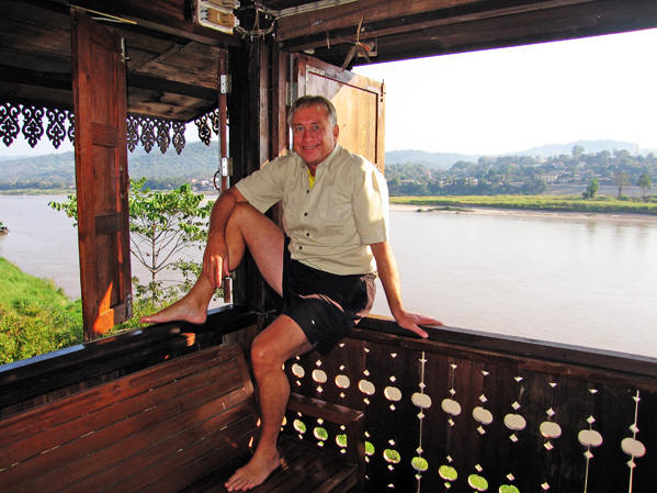 Billy resting on the teak window ledges of the Ruan Thai Lodge