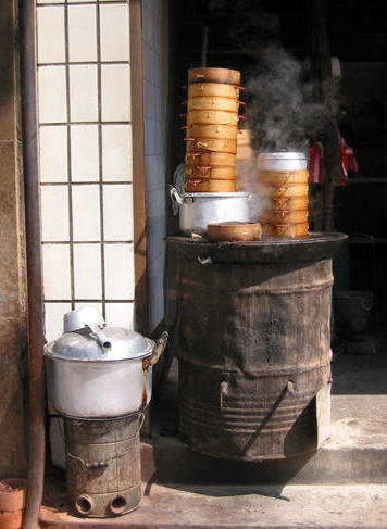 BAMBOO FOOD STEAMERS PILED HIGH