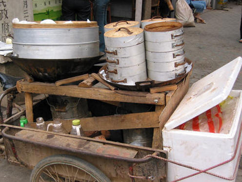 VENDOR'S FOOD CART WITH DUMPLINGS AND BAMBOO STEAMERS