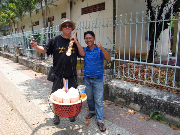 Billy with coconut vendor