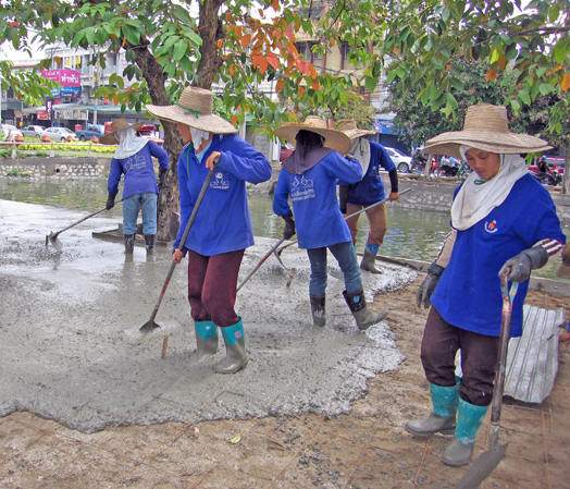 Thai women working in proud cooperation. Chiang Mai, Thailand