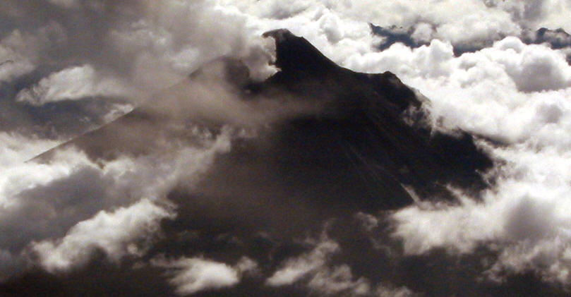 SPEWING SMOKE AND ASH, ACTIVE VOLCANO TUNGURAHUA 5016 METERS
