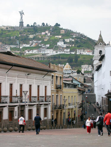 THE VIRGIN PROTECTS THE OLD TOWN, QUITO BELOW