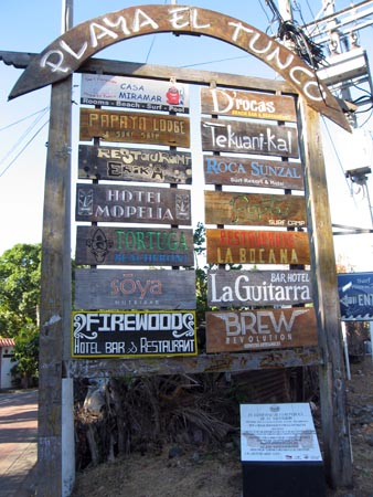Hotels and restaurants listed on this painted wooden sign