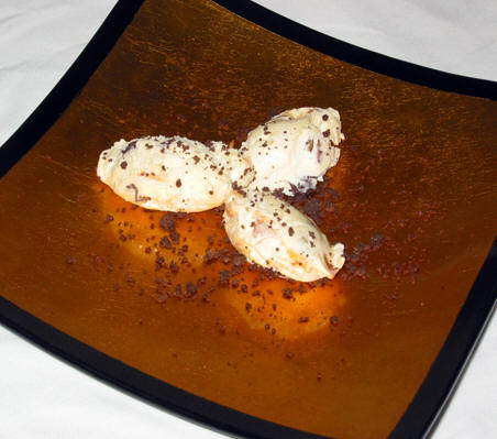 3 dollops of ice cream on a lacquerware plate