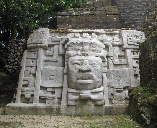 Face of an ancient Maya king carved in stone. Lamanai, Belize