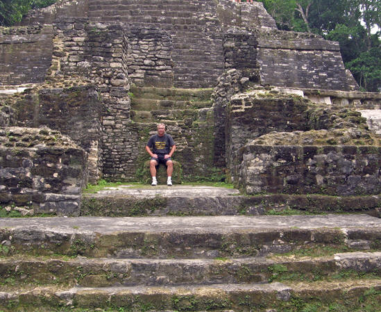 Billy sitting on the steps of the temple, Lamanai, Belize