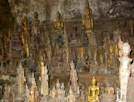 ANCIENT BUDDHA IMAGES INSIDE OF CAVE