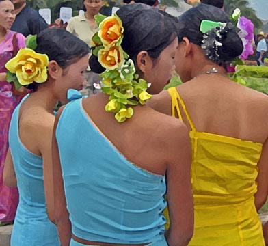 Chinese women with flowers in their hair, Jinghong, China