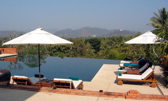 INFINITY POOL AT PAN SEA WITH WAT PHOU SI IN DISTANCE