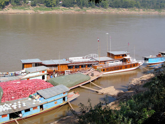 RIVER BOATS DOCKED ON THE MEKONG RIVER