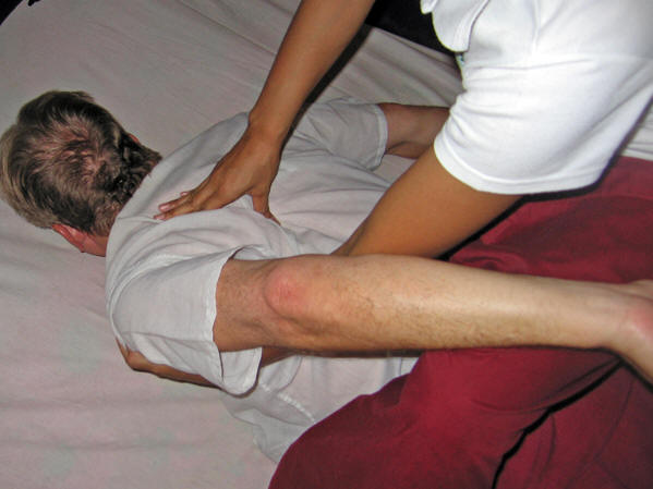 May is getting into the nooks and crannies for hidden tension. Thai massage, Chiang Mai, Thailand