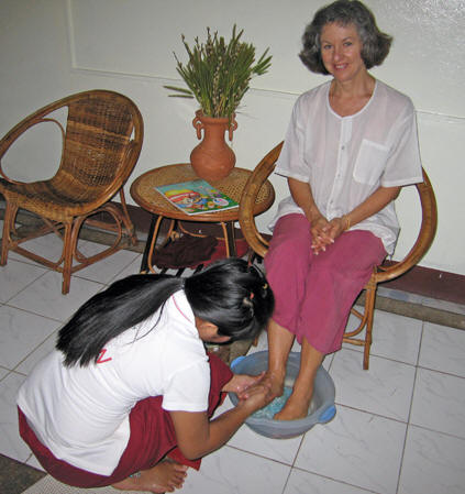Akaisha having her feet washed by Thai massage technician. Chiang Mai, Thailand
