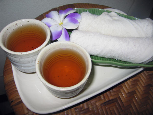 Cups of hot tea and cold towels. Thai massage, Chiang Mai, Thailand