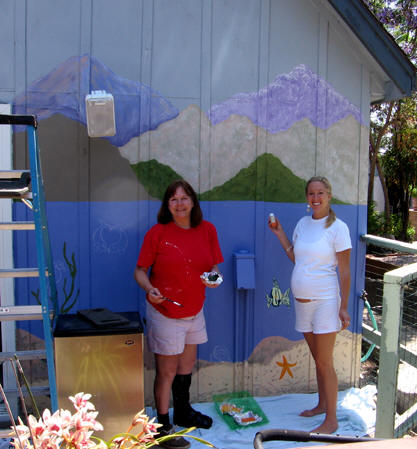 My sister and her daughter painting details on the back wall. Santa Cruz, California