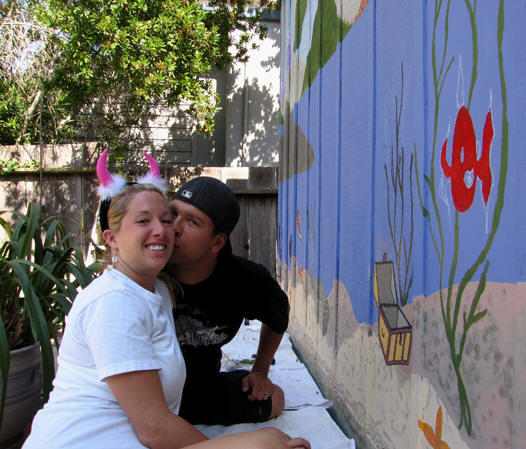 My niece in fuzzy devil horns and her husband both painting on the back wall. Santa Cruz, California