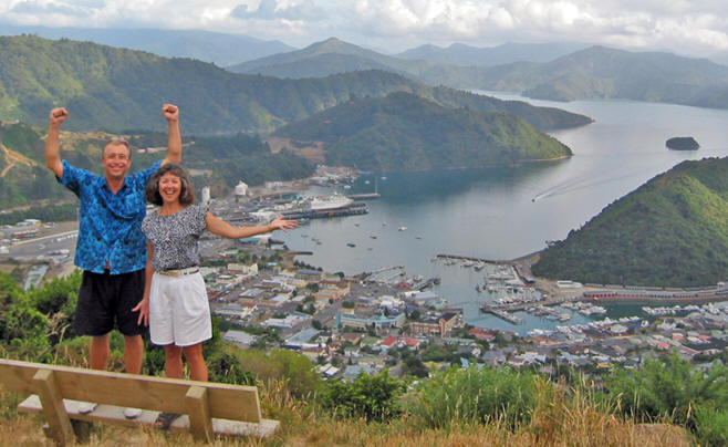 Billy and Akaisha high up on a trail in Picton, New Zealand with harbor behind them