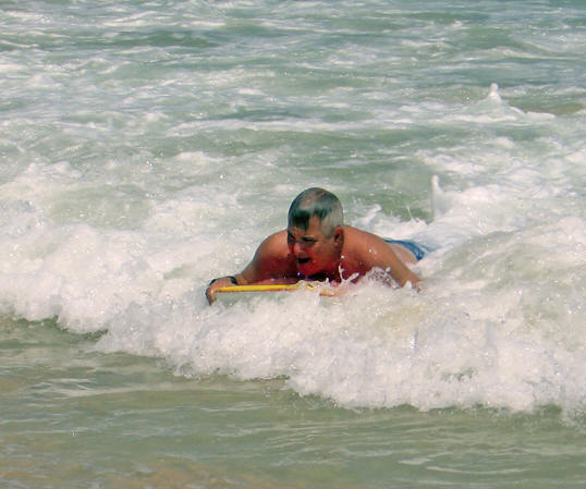 Paul coming in hard from a big wave on his boogie board