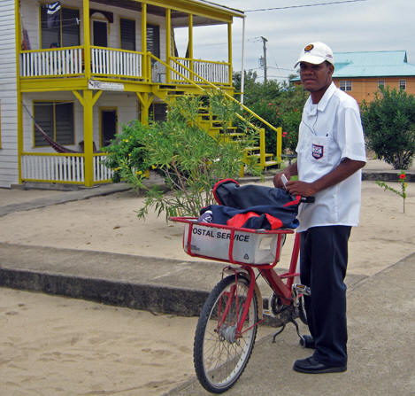 Placencia's Post Man on a bicycle. Belize