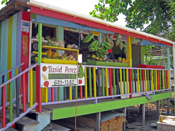 Brightly painted David Perez's Fruit Stand, Placencia, Belize
