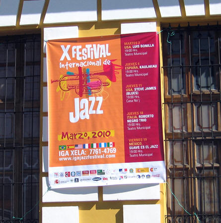 A colorful sign advertises an international Jazz concert with musicians from the USA