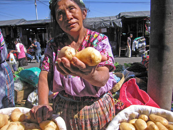 A day market in the streets. This vendor shows her fresh produce.