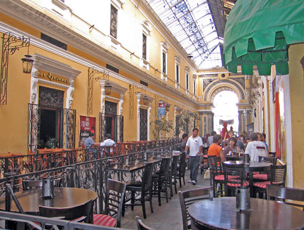 An enclosed area filled with restaurants, language schools, internet cafes, coffee shops and with architecture reminiscent of Europe.