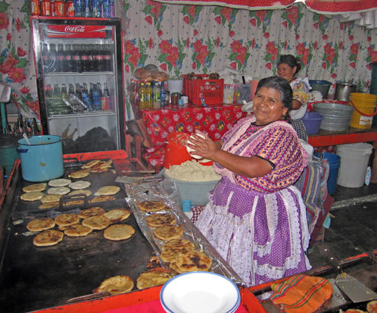 A Mayan Mama making fresh tortillas.