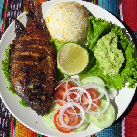 Fish lunch platter with the head of the fish still on, Guatemala
