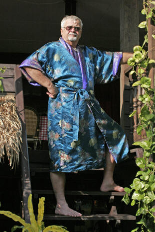 Don in a stunning teal and purple silk robe, Chiang Mai, Thailand