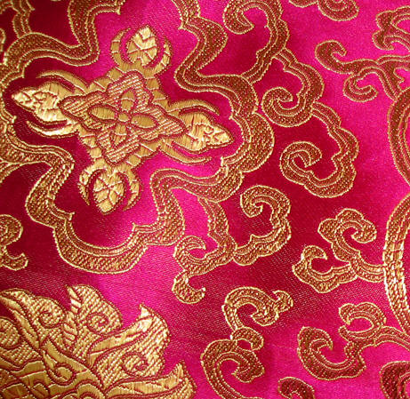 Close up of red Chinese silk with gold embroidery Chiang Mai, Thailand