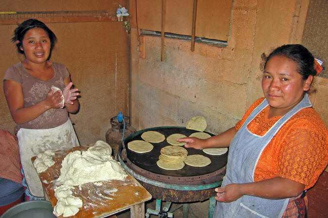 The ever present mound of masa, corn tortillas grilling