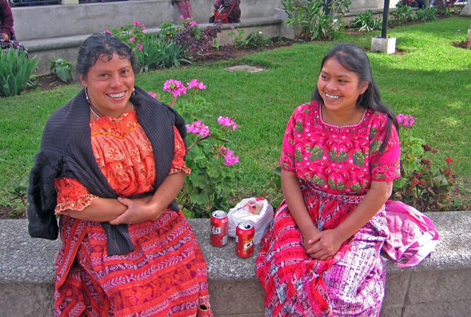 Maya women in hand woven skirts and embroidered huipiles.