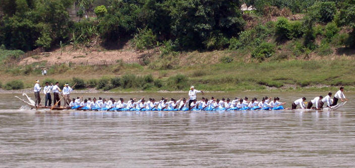 40 Chinese women row boats in races on the Mekong River as 9 Men guide and direct