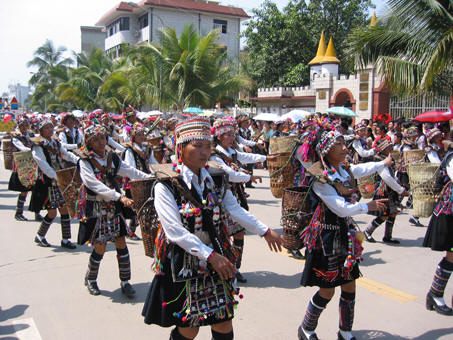 Native tribes in indigenous clothing performing in the Songkran Parade Jinghong, China