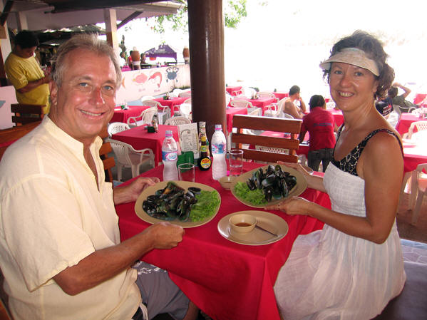 Billy and Akaisha with plates full of fresh mussels, Kata Beach, Thailand