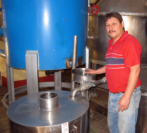 Our guide at El Llano proudly explains the distilling process