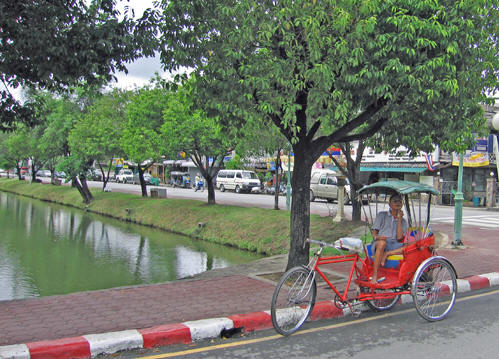 Taking a break along the moat in Chiang Mai