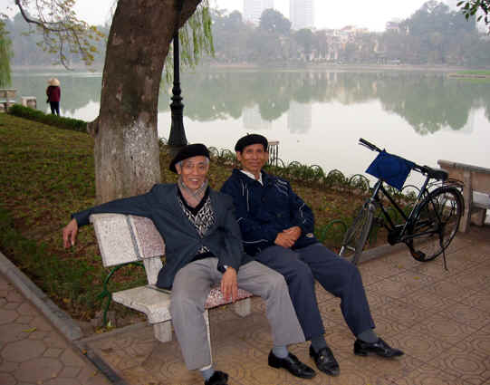 VIETNAMESE MEN ON PARK BENCH